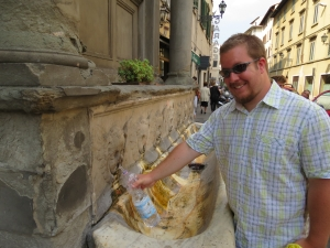 My husband, filling up our infamous water bottle in Florence, Italy.